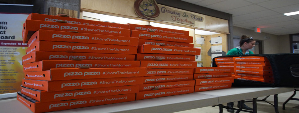 Several stacked pizza boxes.